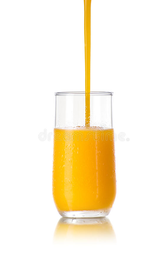 Pouring Cold Juice in a Glass stock images