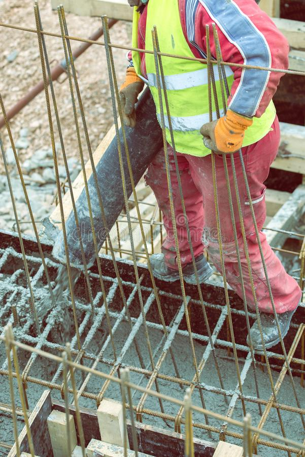 Pouring concrete from cement mixer on concreting formwork 2. Pouring concrete from cement mixer on concreting formwork. Pour concrete footings foundation with royalty free stock photography