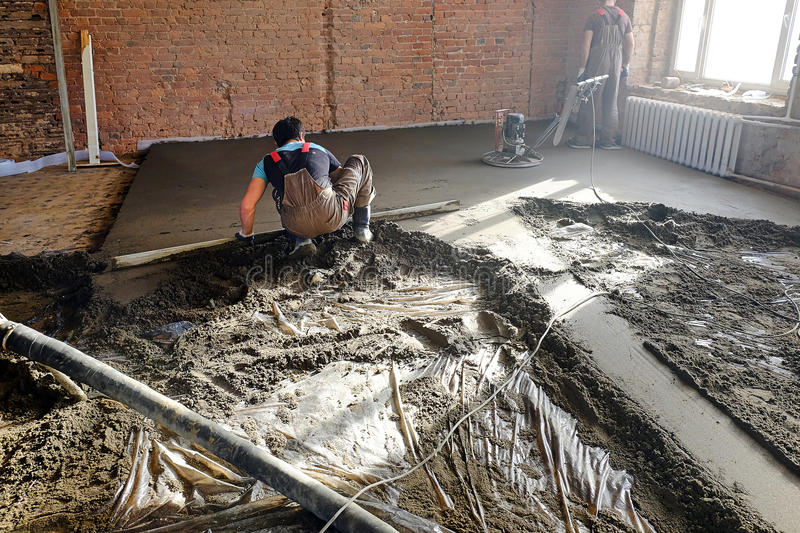 Pouring the concrete floor stock photo
