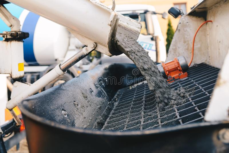Pouring concrete from a concrete mixer to the pump - pouring con. Crete slab royalty free stock photos