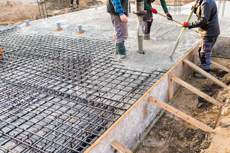 pouring concrete slab stock image