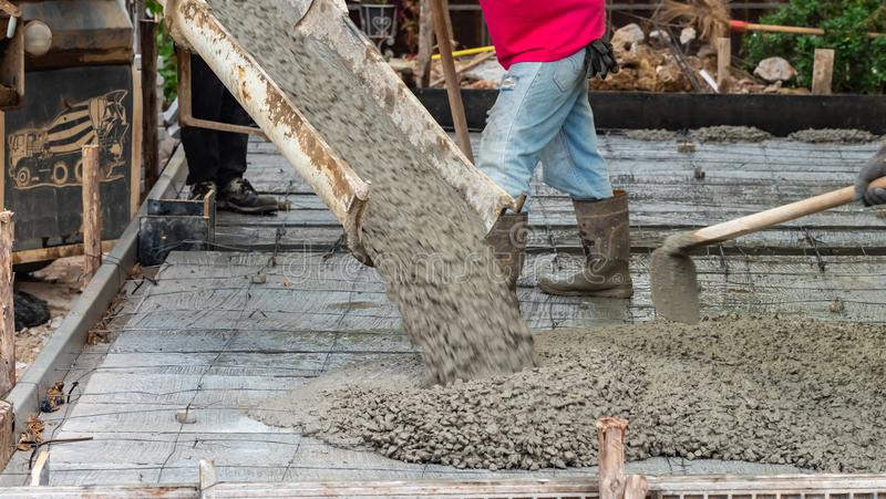 Pouring concrete to the ground in construction site stock photo