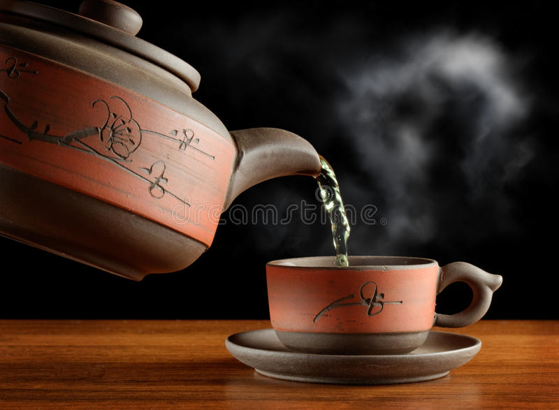 Pouring a cup of tea stock photo