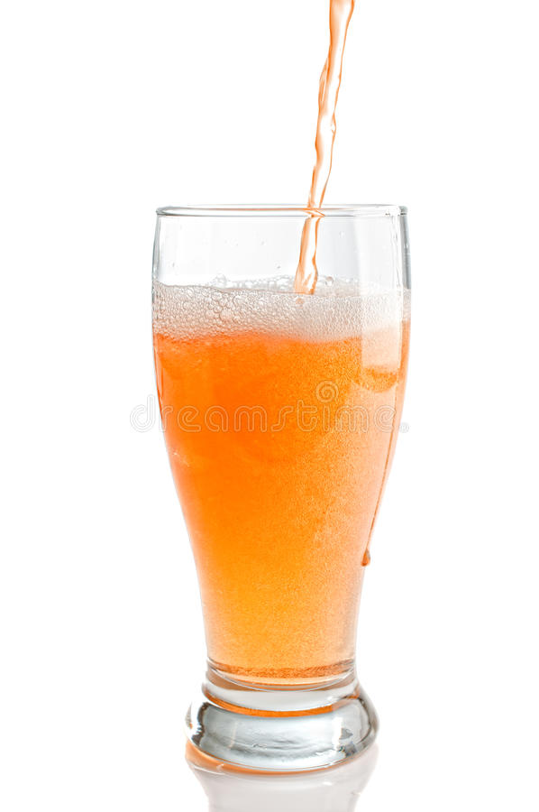 Pouring a Glass of Cider. Pouring a refreshing glass of scrumpy cider on white background stock photo