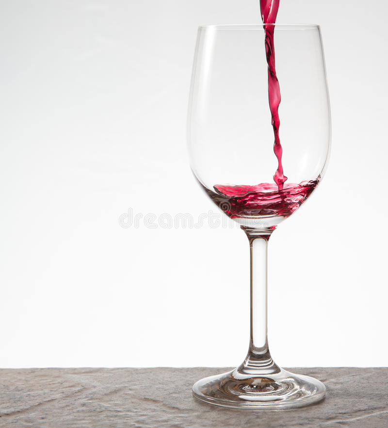 Pouring a glass of wine royalty free stock images