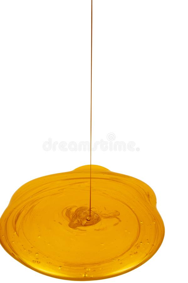 Pouring golden paint on white surface stock image