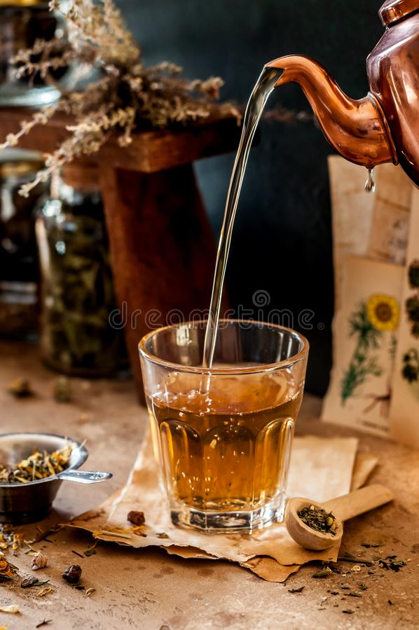 Pouring Herbal Tea royalty free stock image