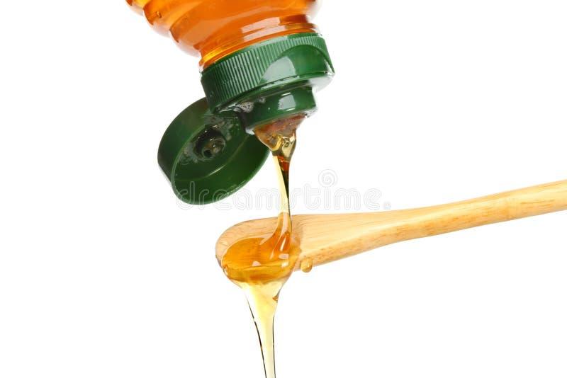 Pouring honey stock photos