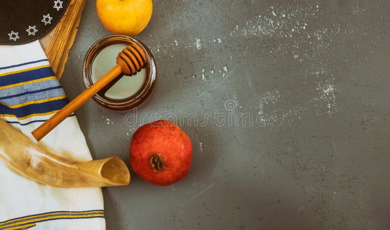 Pouring honey on apple and pomegranate with honey symbols of Jewish New Year - Rosh Hashanah. Pouring honey on apple and pomegranate with honey symbols of Jewish stock photos
