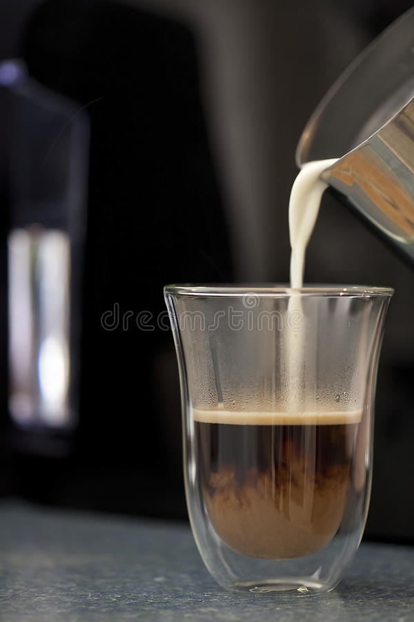 Hot Milk Coffee Cup Glass Coffee - Pouring royalty free stock image