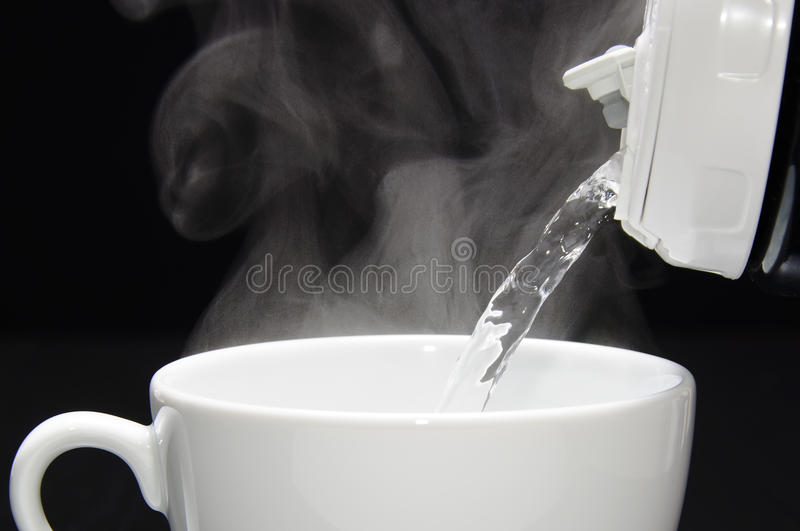 Pouring hot water stock photos