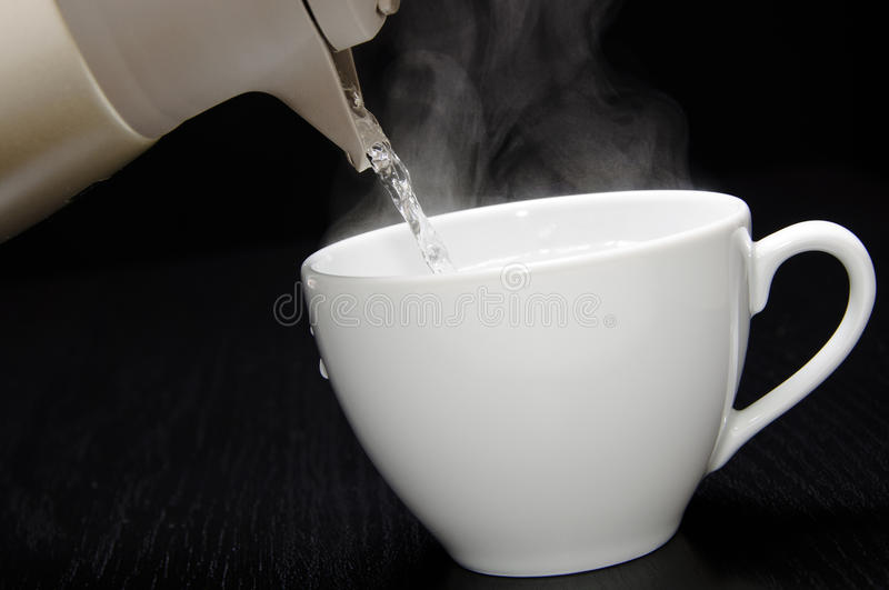 Pouring hot water. Close-up of pouring Hot steaming water for tea stock photos