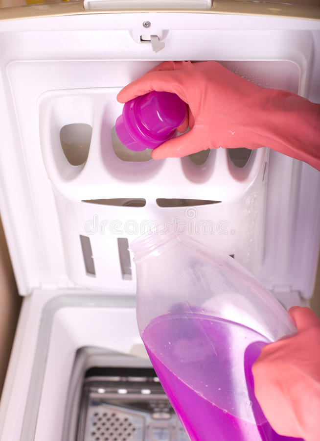 Download Pouring Laundry Detergent Into Washing Machine Stock Photo
