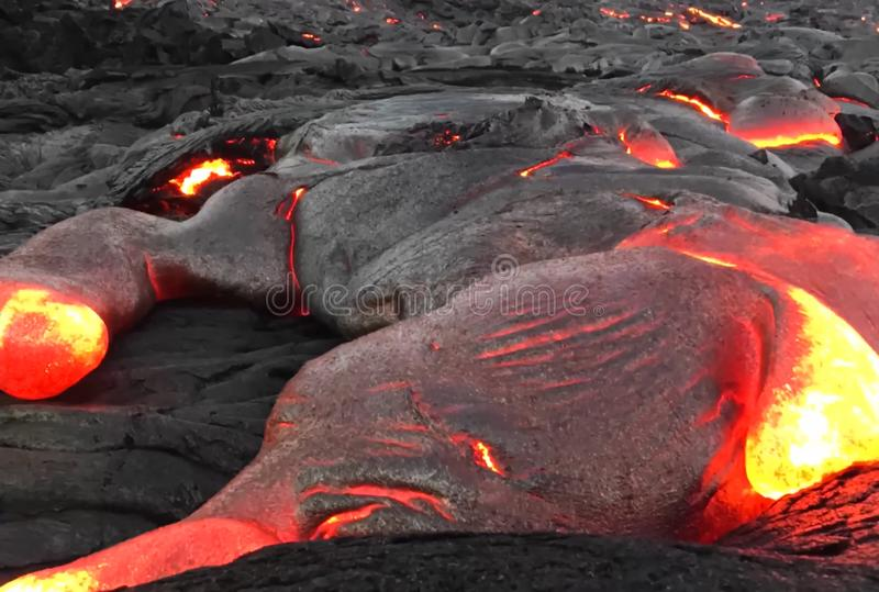 Pouring lava on the slope of the volcano. Volcanic eruption and magma. Pouring lava on the slope of the volcano. Volcanic eruption and magma stock images