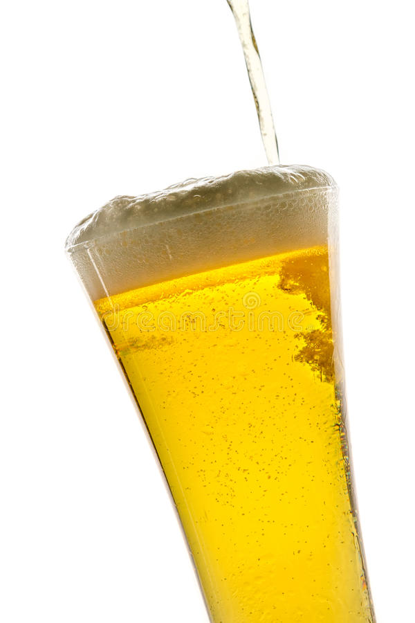 Pouring light beer into glass stock photos