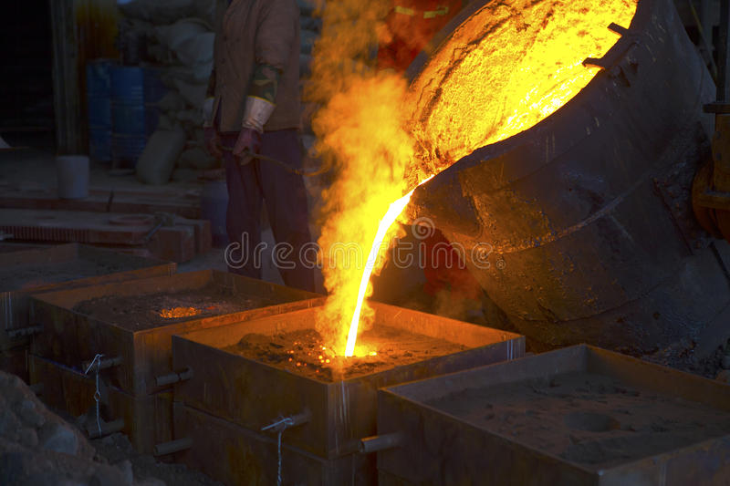 Pouring of liquid metal. Inside of plant royalty free stock images