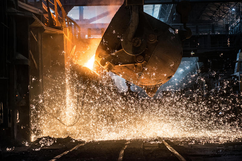 Pouring of liquid metal in open-hearth furnace royalty free stock photography