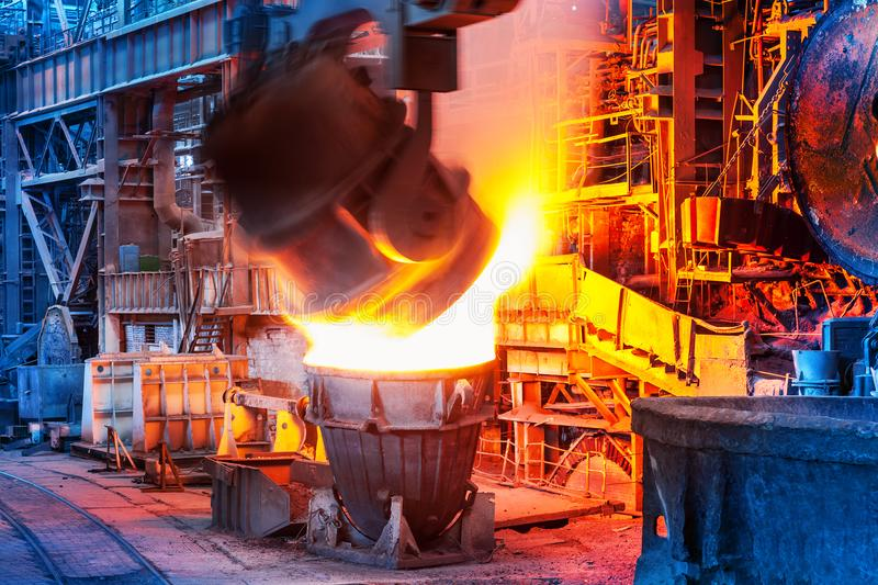 Pouring of liquid metal in open hearth workshop. Of the heavy industry metallurgical plant royalty free stock image