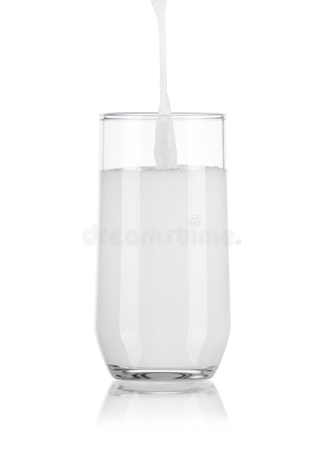 Pouring Milk in Glass royalty free stock photo
