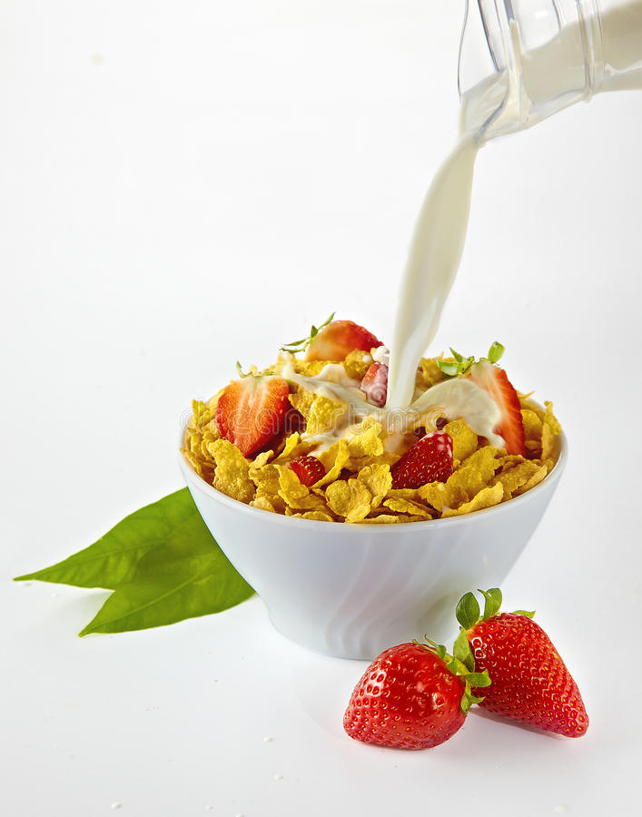 Free Pouring Milk In Cornflakes Bowl With Strawberries Royalty Free Stock Image - 24588566