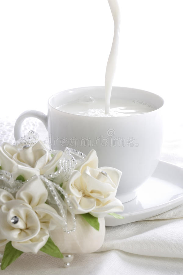 Free Pouring Milk Into White Cup Stock Photography - 37622022