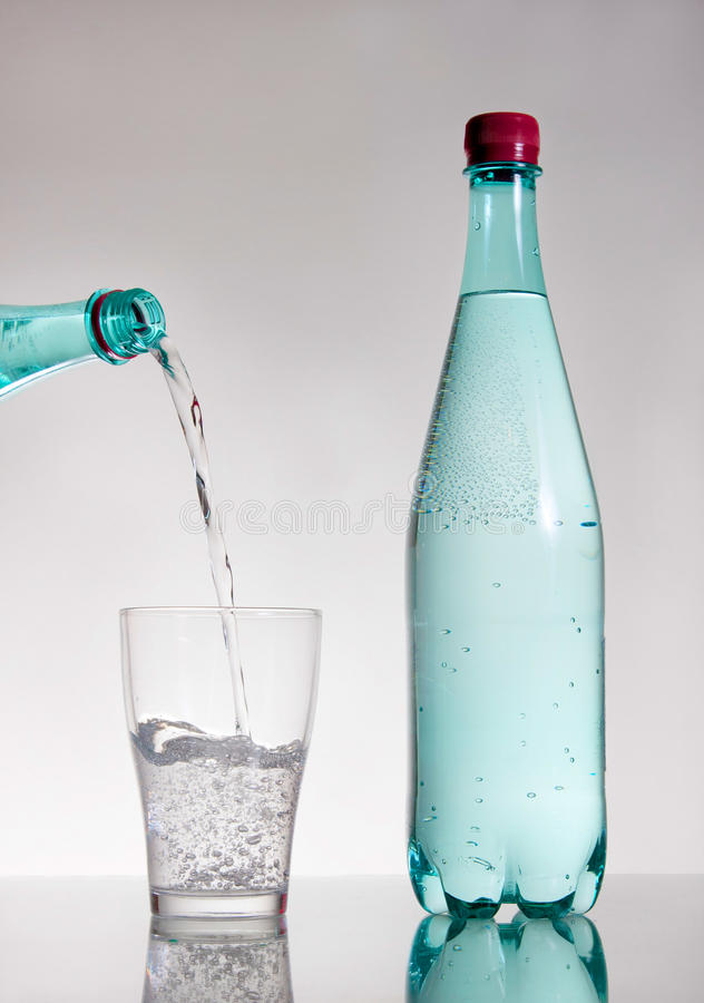 Pouring mineral water royalty free stock image