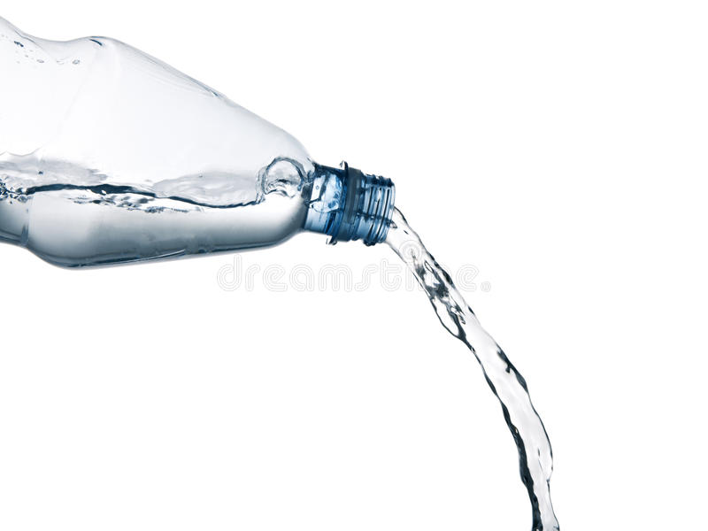 Pouring mineral water from a bottle royalty free stock photos