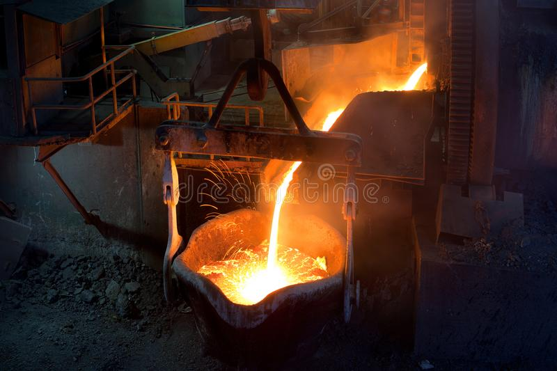 Pouring molten copper. At a Copper Mill in Chile stock photos
