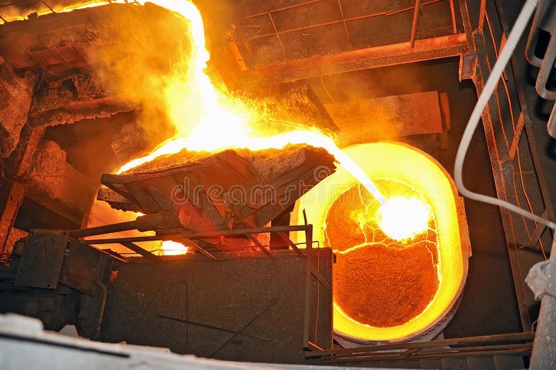 Pouring molten steel. Inside of steel plant royalty free stock photos