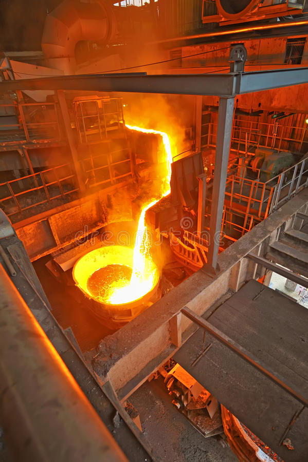 Pouring molten steel. Inside of plant stock photo