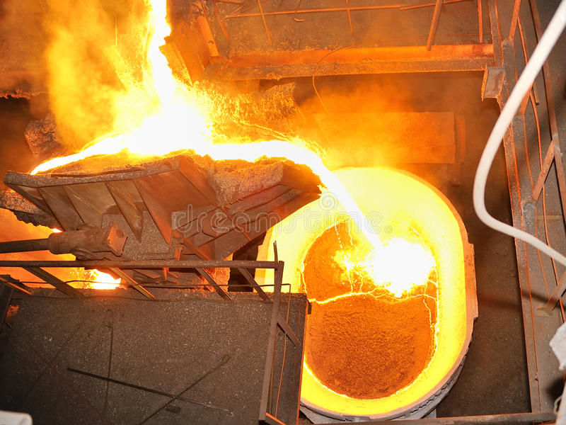 Pouring molten steel in transportation device. Insidee on factory stock photo