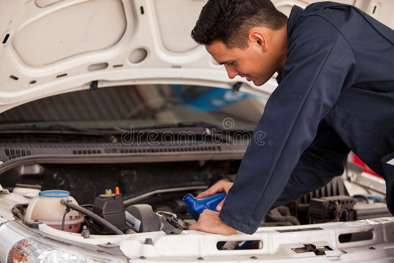 Download Pouring new oil into a car stock image. Image of hispanic - 33750429