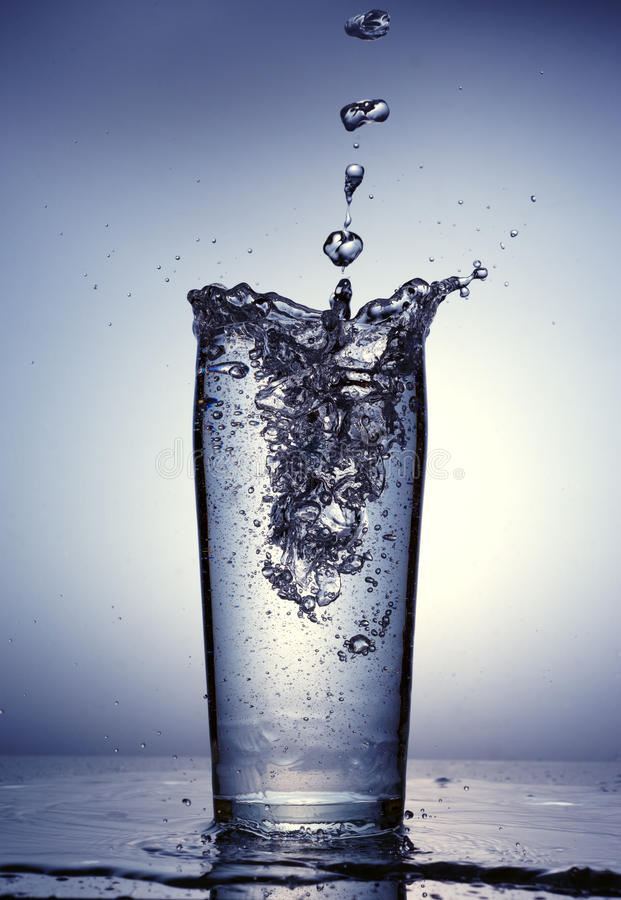 Free Pouring Of Clean Water In A Clear Glass. Stock Image - 38638191