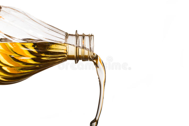 Pouring oil stock photography