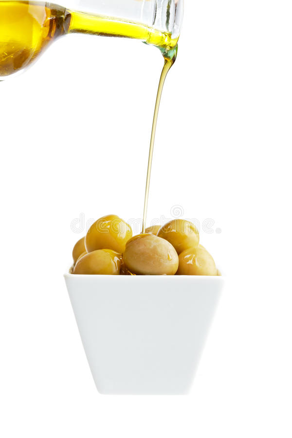 Download Pouring olive oil stock photo. Image of container, liquid - 12725804