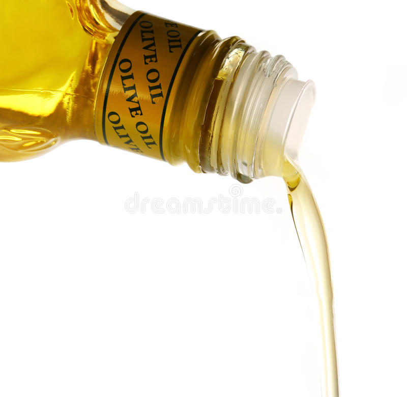 Pouring olive oil. From bottle stock image