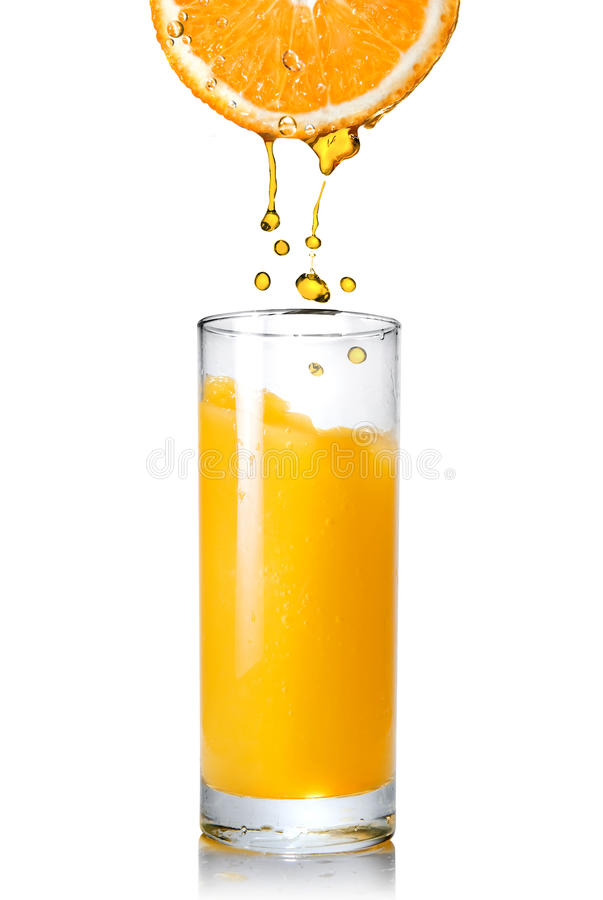 Free Pouring Orange Juice From Orange Into The Glass Stock Images - 14020414
