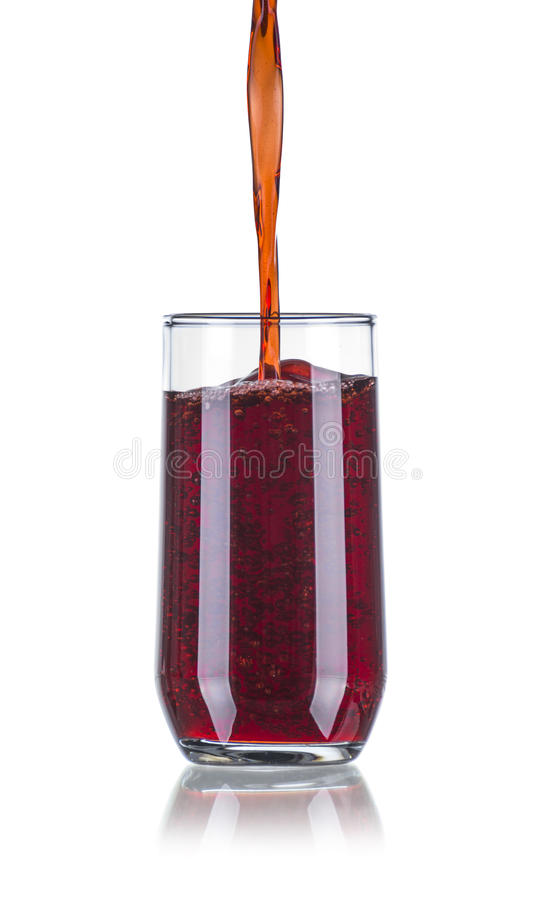 Pouring Red Beverage in a Glass stock image