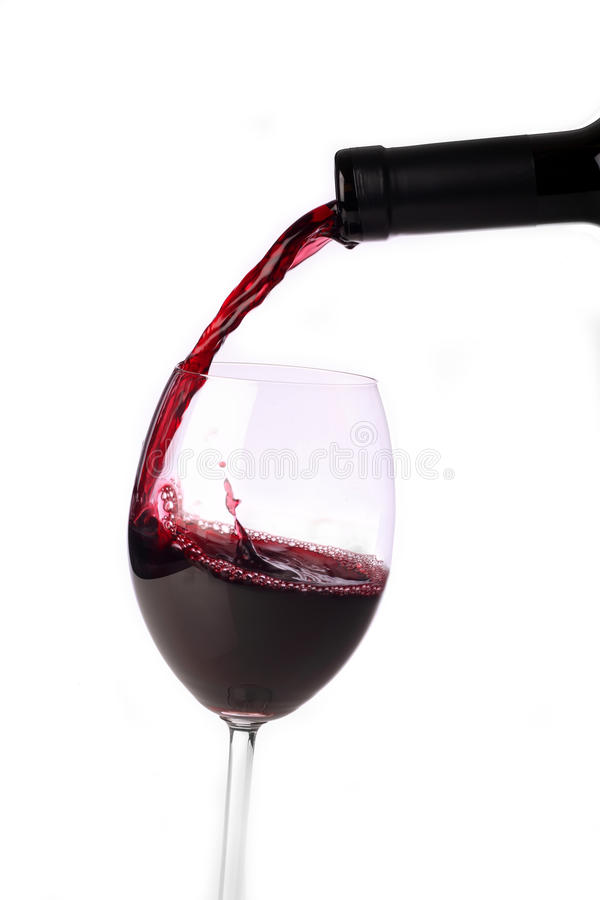 Pouring red-wine. Into a wine glas royalty free stock photos