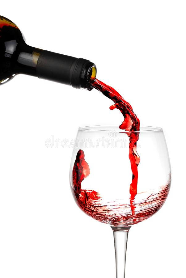 Pouring red wine. In a glass. Close up royalty free stock images