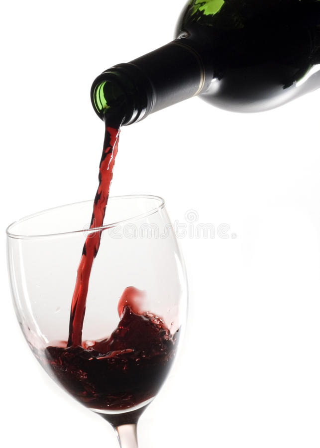 Pouring Red Wine. In glass with white background stock photos