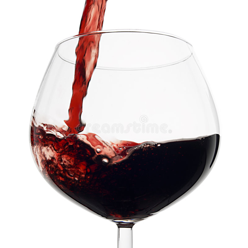 Pouring red wine. In a glass stock image