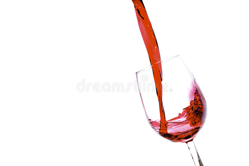 Pouring red wine. Into a tilted glass stock photos