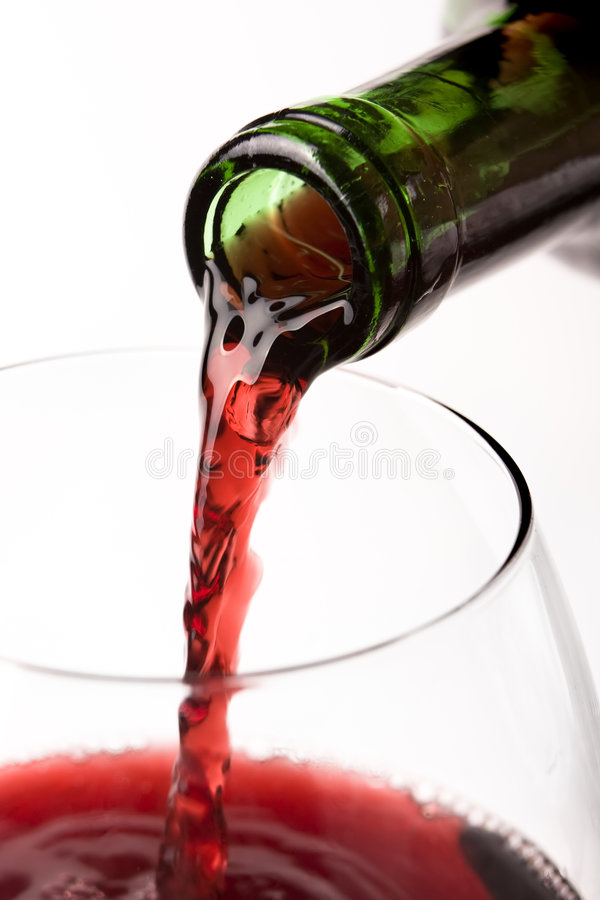 Pouring Red Wine From Bottle Stock Photos