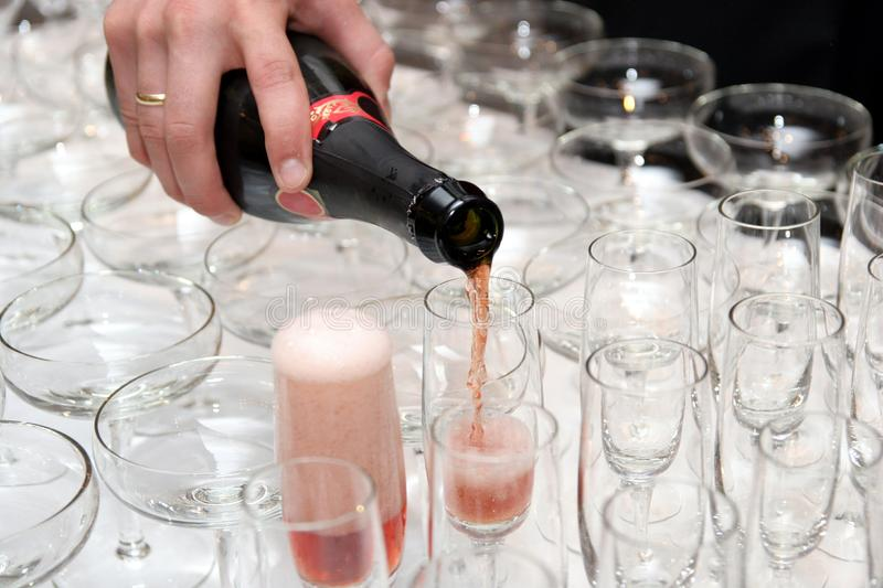 Pouring red wine in cup royalty free stock images