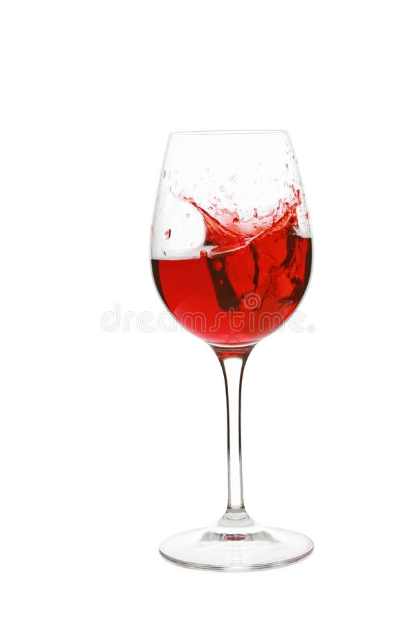 Pouring red wine in glass. Isolated on a white background stock photos