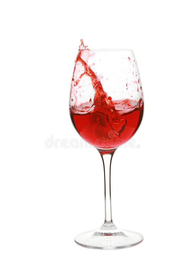 Pouring red wine in glass. Isolated on a white background stock images