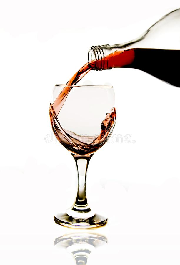 Pouring red wine in glass stock images