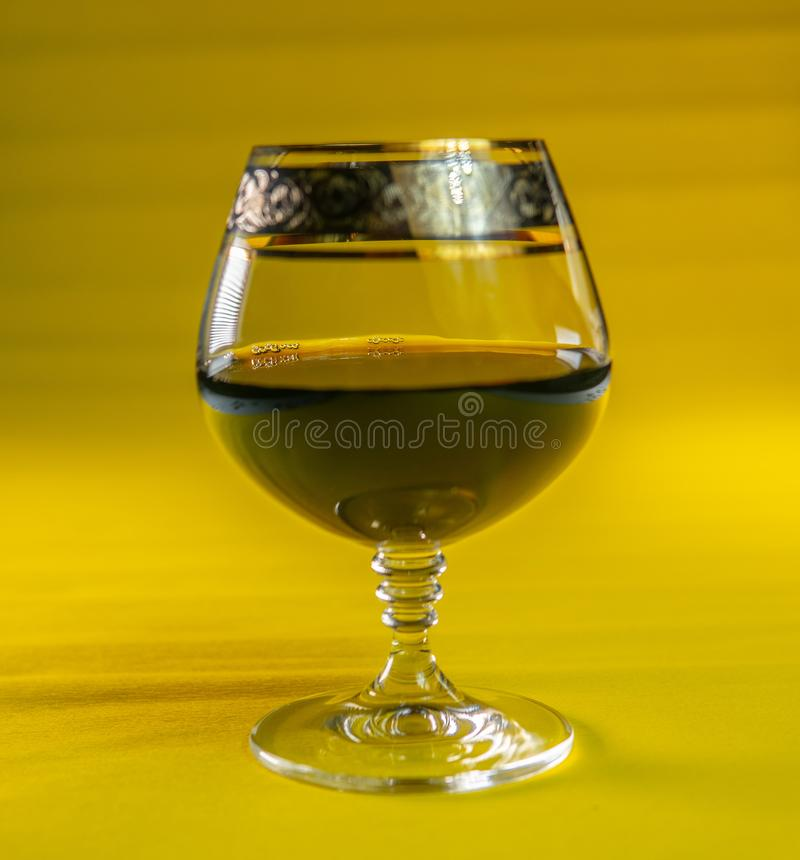 Pouring red wine into the glass. Pour red wine. Glass stock photos