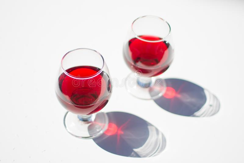 Pouring red wine in a glass stock photos